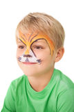 Happy little boy in tiger face paint Royalty Free Stock Images