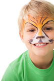 Happy little boy in tiger face paint Royalty Free Stock Photos