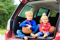 Happy little boy and toddler girl travel by car Royalty Free Stock Images
