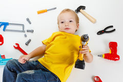 Happy little boy with tools on white background Stock Image