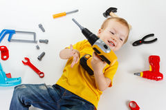 Happy little boy with tools on white background Stock Images