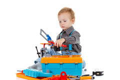 Happy little boy with tools on white background Royalty Free Stock Photo