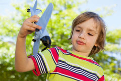 Happy little boy with toy airplane Royalty Free Stock Photos