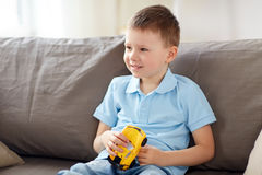 Happy little boy with toy car at home Stock Photo