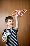 Happy little boy with toy quadcopter drone Stock Photo