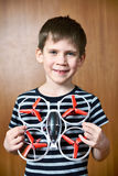 Happy little boy with toy quadcopter drone Stock Photos