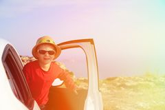 Happy little boy travel by car in mountains Royalty Free Stock Images