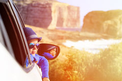 Happy little boy travel by car in mountains Stock Images