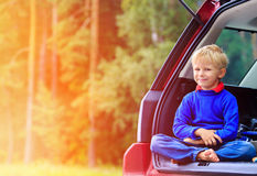 Happy little boy travel by car in nature Royalty Free Stock Images