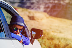 Happy little boy travel by car in nature Stock Photos