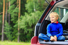 Happy little boy travel by car in nature Stock Image