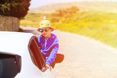 Happy little boy travel by car on the road Royalty Free Stock Photos