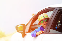 Happy little boy travel by car on the road Royalty Free Stock Photo
