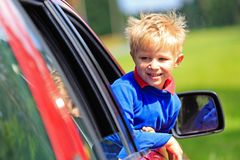 Happy little boy travel by car in summer Stock Images