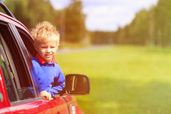 Happy little boy travel by car in summer Royalty Free Stock Photo
