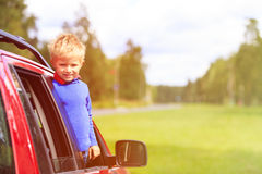 Happy little boy travel by car in summer Stock Photo