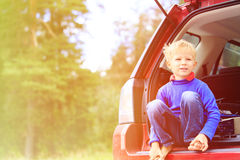 Happy little boy travel by car in summer Stock Image