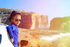 Happy little boy travel by car on summer vacation Royalty Free Stock Photos