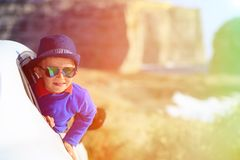 Happy little boy travel by car on summer vacation Royalty Free Stock Photo