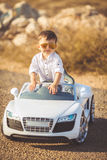 Happy little boy travel by car in summer Royalty Free Stock Photography