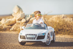 Happy little boy travel by car in summer Stock Photography