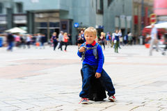 Happy little boy travel in the city of Europe Royalty Free Stock Photo