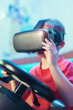 Happy little boy in virtual reality glasses playing video game Royalty Free Stock Photography