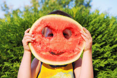 Happy little boy with watermelon Stock Images