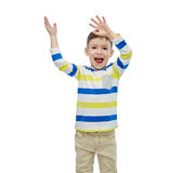 Happy little boy waving hands Royalty Free Stock Image