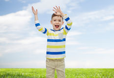 Happy little boy waving hands Stock Images