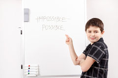 Happy little boy and white board Stock Photography
