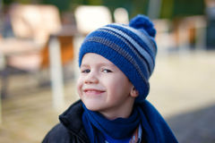 Happy little boy in winter cap and scarf Royalty Free Stock Photography