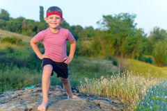 Happy little boy working out in nature Stock Photos