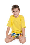 Happy little boy in the yellow shirt Royalty Free Stock Photo