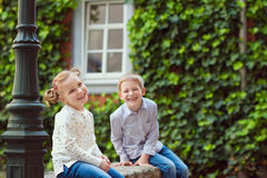 Happy little brother and sister playing Stock Photography