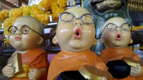 Happy little Buddhist monk dolls Royalty Free Stock Photos