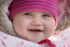Happy little caucasian baby in winter clothes Royalty Free Stock Image