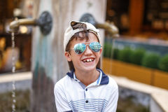 Happy little caucasian boy in cap laughing Royalty Free Stock Image