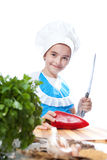 Happy little chef cook cuts Bell Pepper Stock Photo