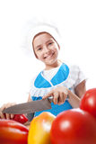 Happy little chef cook cuts Bell Pepper Royalty Free Stock Photos