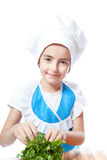 Happy little chef cook with parsley Royalty Free Stock Photo