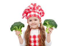 Happy little chef girl with broccoli Stock Images