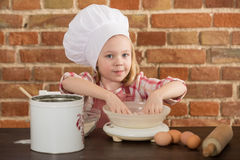 Happy little chef in the kitchen Stock Photography
