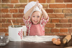 Happy little chef in the kitchen Royalty Free Stock Photo