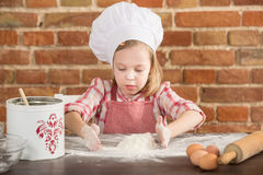 Happy little chef in the kitchen Royalty Free Stock Images