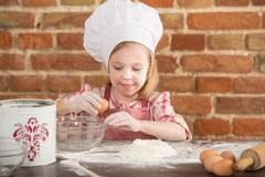 Happy little chef in the kitchen Stock Photos