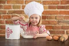 Happy little chef in the kitchen Stock Image