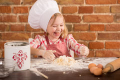 Happy little chef in the kitchen Royalty Free Stock Photography