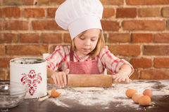 Happy little chef in the kitchen Royalty Free Stock Image