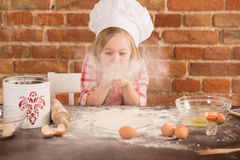 Happy little chef in the kitchen Royalty Free Stock Photos
